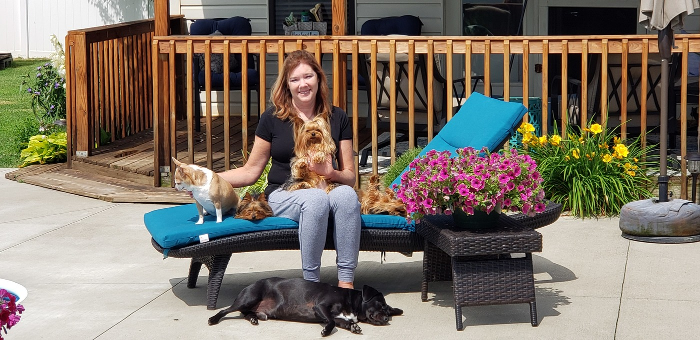 Kim surrounded by all her dogs!